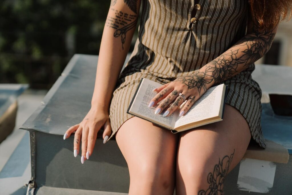 tattooed girl reads book of myths